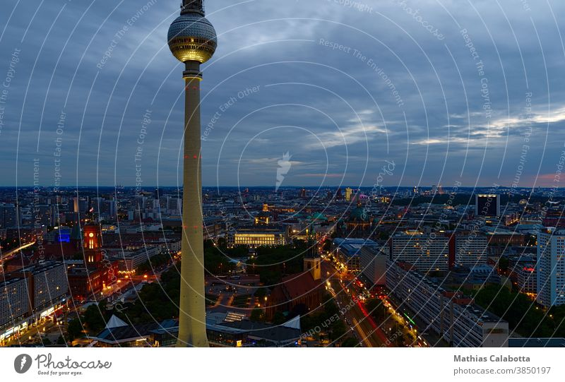 Berlin television tower photographed at sunset with long exposure Television tower Night Skyline Tower Alexanderplatz Building City Europe Germany Square