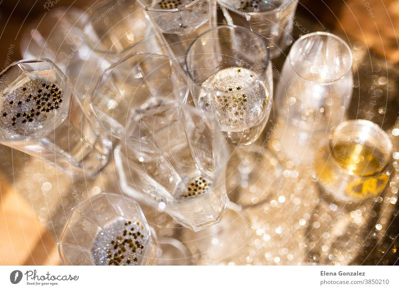 Several champagne glasses over gold christmas background. Celebrating new year concept. merry christmas lights sparkle greetings congratulations years ornaments