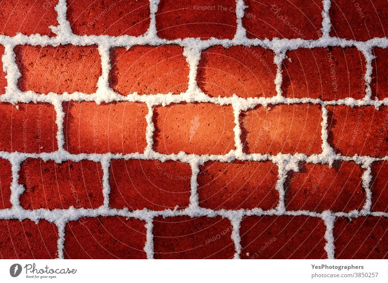 Red brick wall with snow. Red Christmas background.  Winter backdrop with snow Merry Christmas advertising christmas copy space december decoration decorative