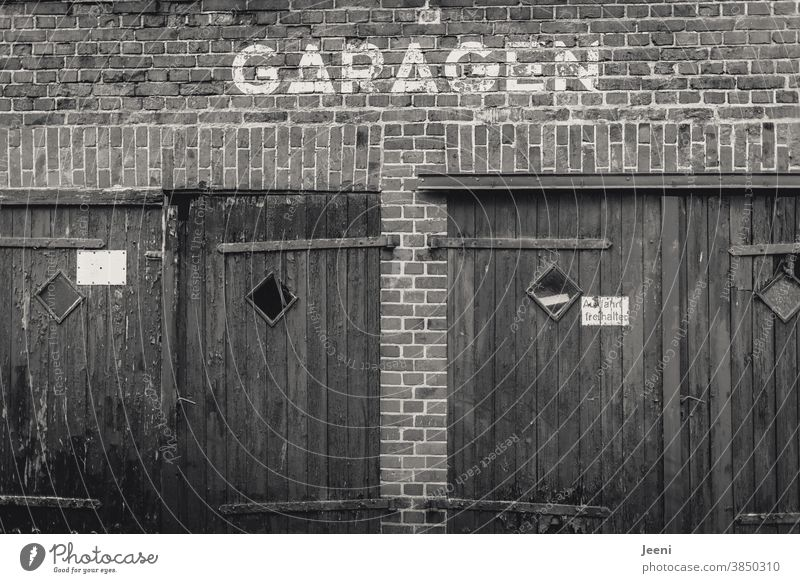 Two old sad garages Garage Garage door Garage doors Wall (building) Wall (barrier) Brick wall pediment Facade Gloomy Old two black-and-white Black & white photo