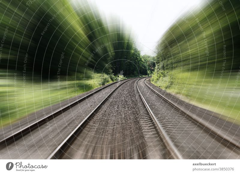 double-track railroad railway or train tracks speed motion blur travel moving fast journey traveling transportation distance vacation landscape nature trees
