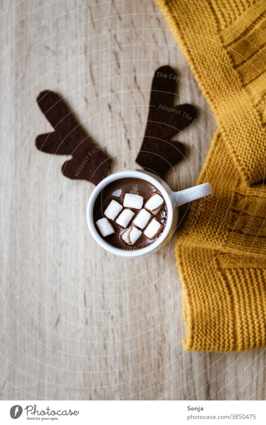A cup of hot chocolate with marshmallows and felt reindeer antlers Hot chocolate Hot Chocolate Felt Humor Dessert Delicious Brown Tasty Breakfast cute