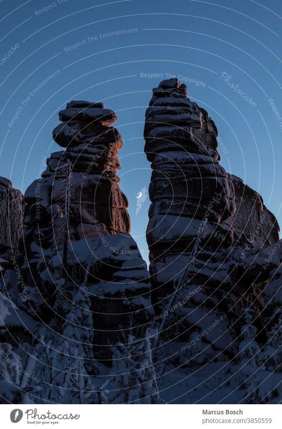 Winter landscape in the evening light Triple chair Triple chair rocks Rock Frost Summit Rocks granite rocks Sky Hill Highlands Low mountain range landscape Moon