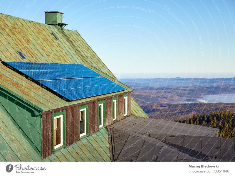 Solar panels on an a roof of an old mountain shelter. solar nature power renewable energy green technology solar panels photovoltaic ecology installation