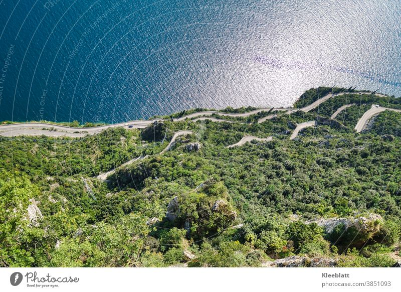 An abyss to shudder 350m into the depth - View of the curved road - Tremosine Shudder Terrace Lake Garda spectacular road course height Landscape Exterior shot