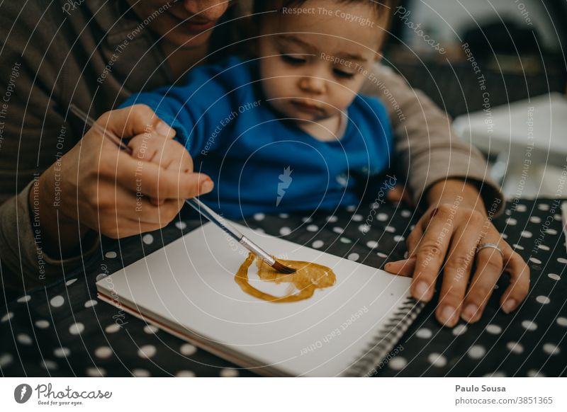 Mother and toddler painting at home 0-09 years 30-39 years Learn and Know Lifestyle affectionate authentic autumn caring casual caucasian child color curiosity