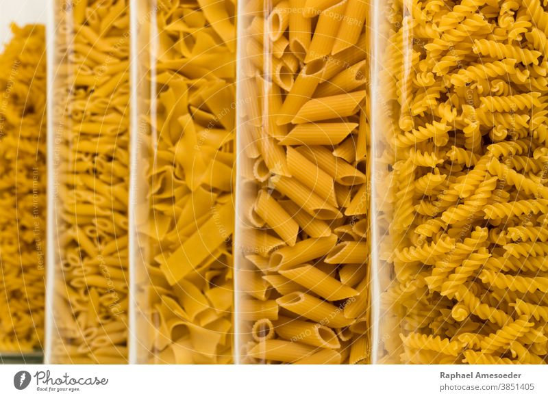Noodle sorts filled in high glasses, studio shot assorted box calories carbohydrate closeup collection cook cooking cuisine culinary decorative delicious dough