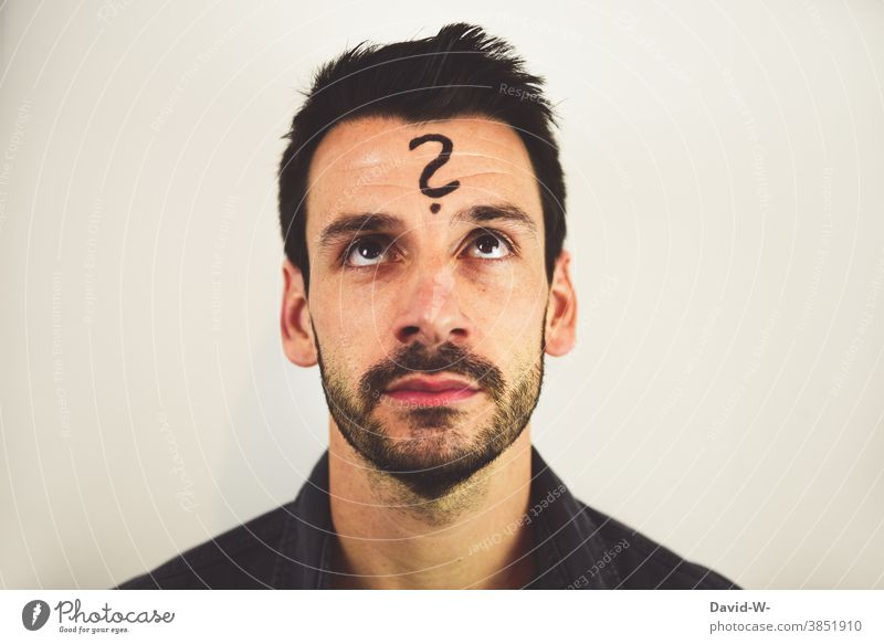 Man with question mark on forehead Meditative Question mark ? Think ponder Asking look Insecure thoughts Future