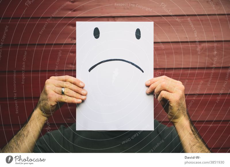 man recorded with sad facial expression - negative smiley on a piece of paper Face Smiley Facial expression Evil Emotions embittered Piece of paper drawing