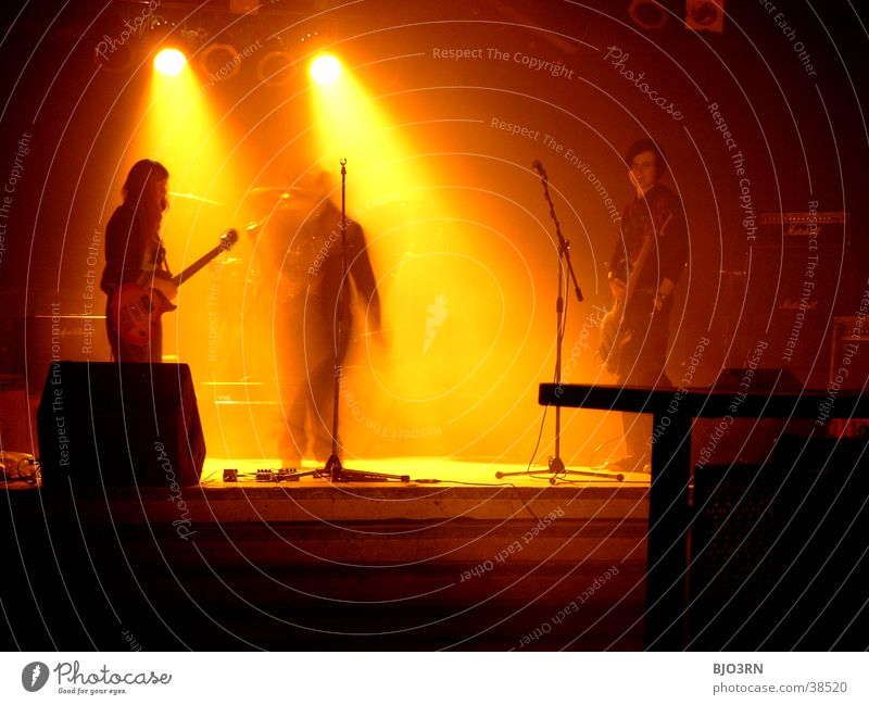 Human being Black Yellow Lamp Music Shows Concert String Guitar Stage Loudspeaker Microphone Floodlight Drum set Double bass Intensifier