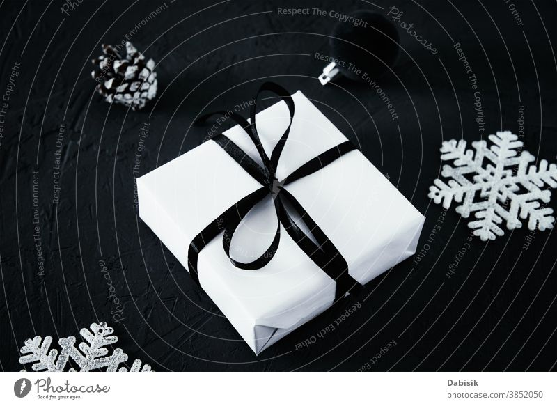 Christmas composition. Gift box with and christmas decorations on dark background, top view gift present merry christmas sale xmas card holiday space concept