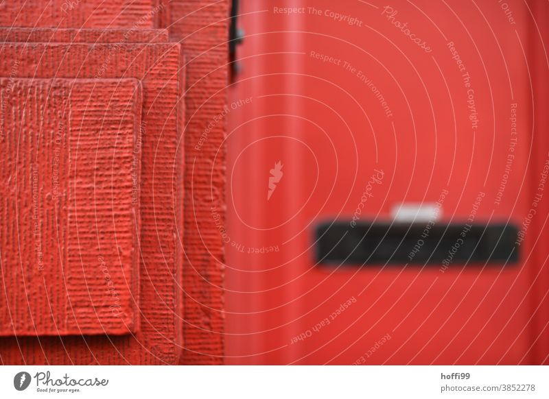 the red corner of the wall jostles into the picture and lets the mailbox only be guessed Red red wall Corner Abstract Architecture Line Wall (building)