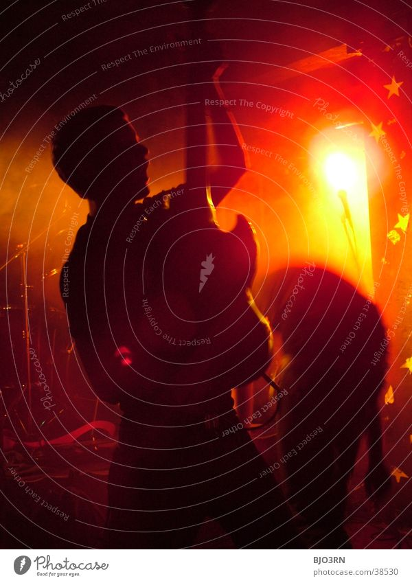 Human being Red Lamp Music Orange Shows Concert String Guitar Stage Loudspeaker Microphone Floodlight Musician Double bass Guitarist