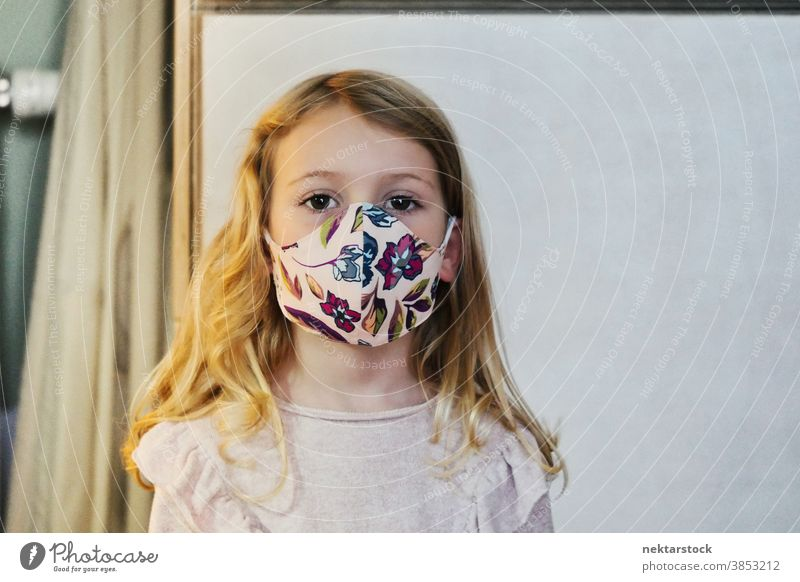 Blond Girl with Protective Face Mask child girl portrait mask protective face mask blond caucasian lifestyle female looking at camera indoor natural lighting