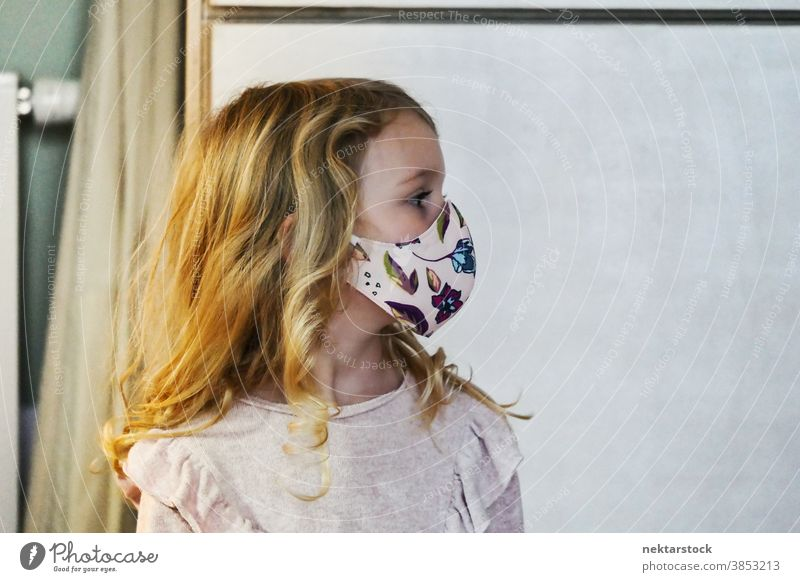Blond Female Child Profile with Protective Face Mask child girl portrait mask profile protective face mask blond caucasian lifestyle female looking away