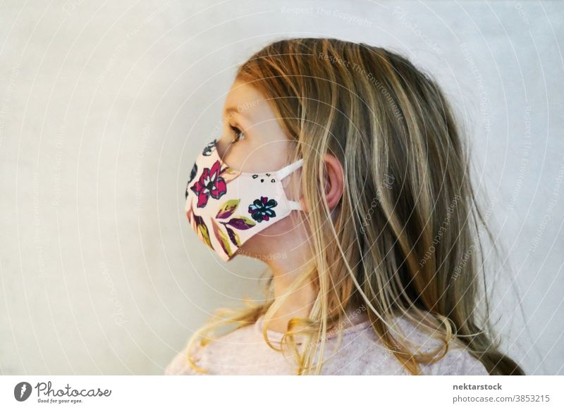 Blond Girl Profile Wearing Protective Face Mask child girl portrait mask profile protective face mask blond caucasian lifestyle female looking away head turned