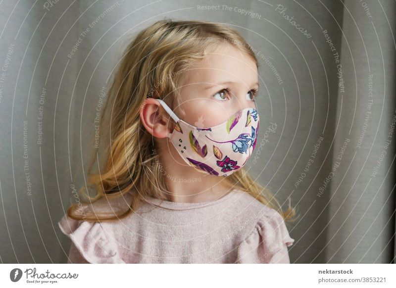 Caucasian Girl Wearing Protective Face Mask Looking Away child girl portrait mask protective face mask blond caucasian lifestyle side view female looking away