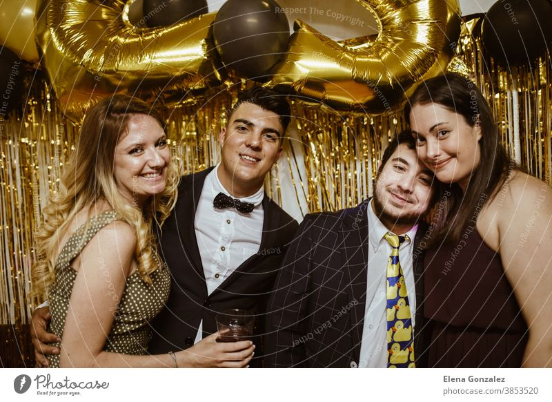 Group of best friends celebrating Christmas or New Year eve. Party time concept christmas merry christmas new year friendship women girls males togetherness