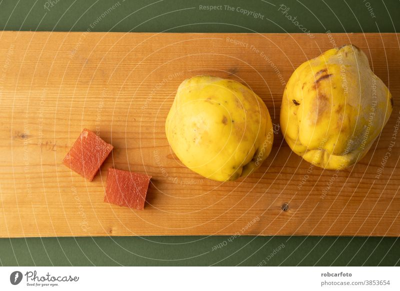 quince fruit on green background sweet fresh wooden food organic ripe autumn season vegetarian tasty closeup natural raw group copy space plate healthy table