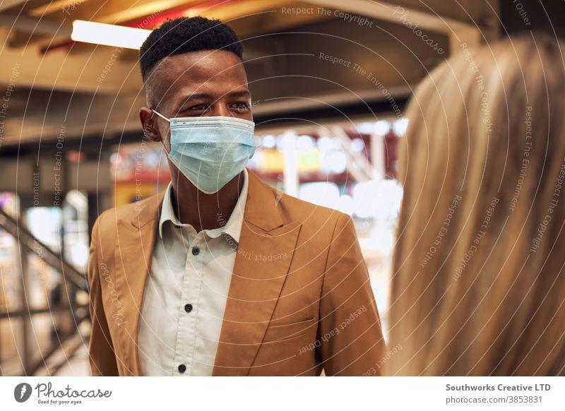 Business Couple Wearing Masks Having Informal Meeting In Office During Health Pandemic business businessman businesswoman face mask face covering wearing