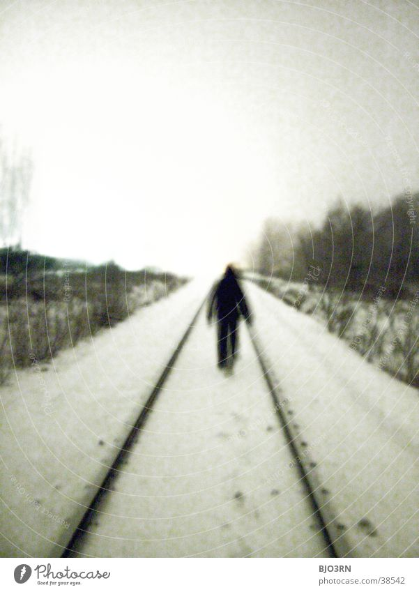 the aisle into the light Loneliness Cold Railroad tracks Human being Snow railway embankment Shadow
