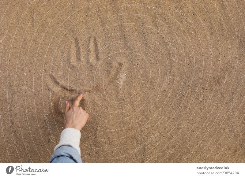 Hand Drawing a Beautiful Cute Smile in Desert Sand - Background smile foot sand holiday fun texture face beach symbol sun joy lifestyle sunny day enjoying