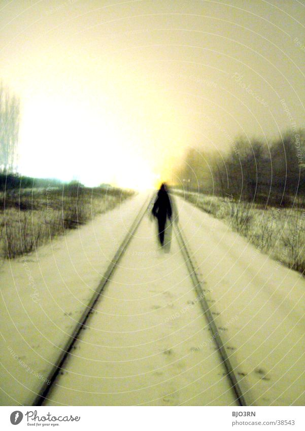 the aisle into the light #2 Loneliness Cold Railroad tracks Human being Snow railway embankment Shadow
