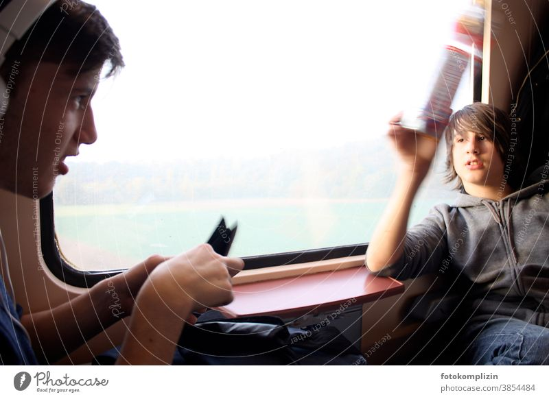 two boys at the window in the train Railroad Passenger train Passenger traffic Parenting Train compartment Student go by train train window Infancy