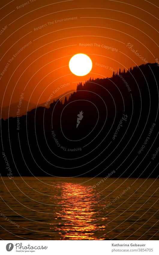 Sunset at Lake Garda Red Water Ocean Evening sunset mountains Landscape Sky Summer Relaxation