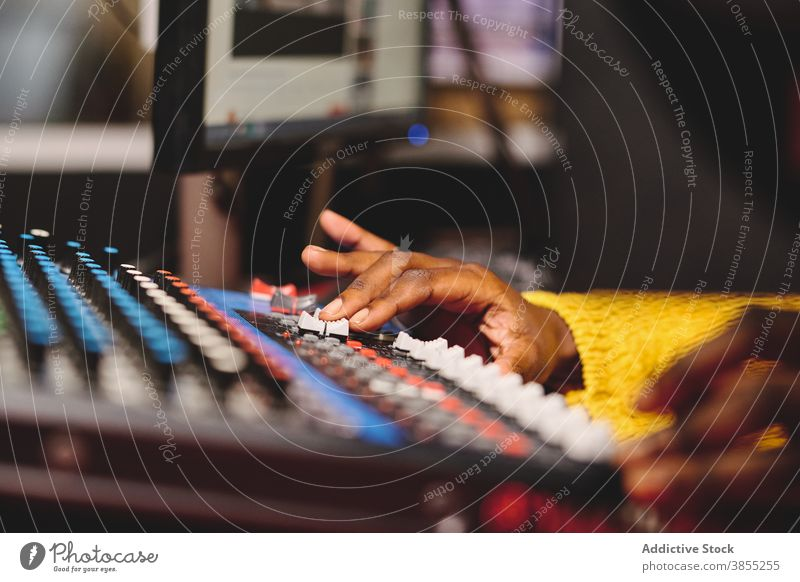 Crop black woman using control panel at radio station mix console broadcast host microphone on air radiocast female ethnic african american audio mixer live