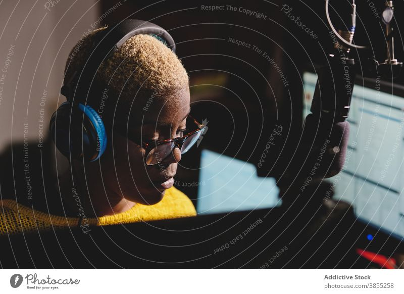 Black woman at radio station broadcast host studio microphone speak cheerful female ethnic black african american dark work job talk professional device live