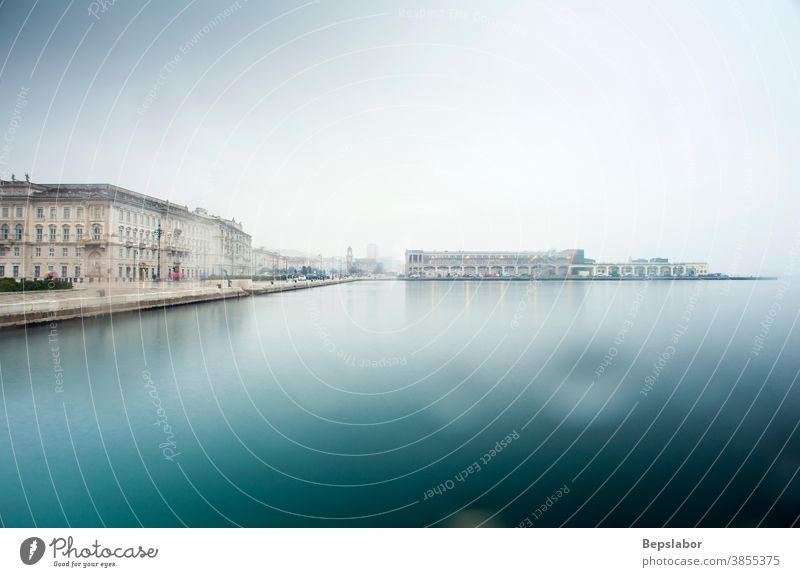View of Trieste historic buildings overlooking the sea in a rainy day trieste italy weather melancholy travel empty nobody lunar atmosphere thunderstorm drops
