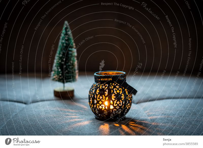 A rustic lantern with candlelight Lantern Black Dark Night Visual spectacle Orange Christmas & Advent Evening Candlelight shoulder stand Flame Warmth Burn