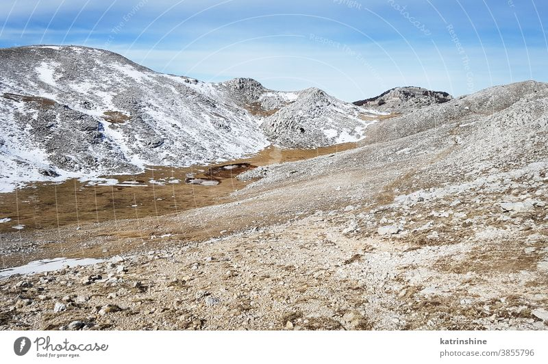 The top of Cervati mountain in Cilento National Park Trail italy Campania diano snow landscape blue stone nature rock sky outdoor trekking hiking path sport