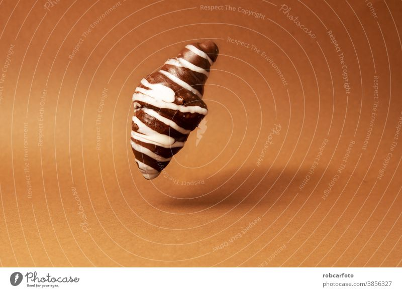 chocolate croissant on brown background sweet fresh tasty bun bake closeup dessert pastry crust food delicious bakery bread french nobody gourmet breakfast meal