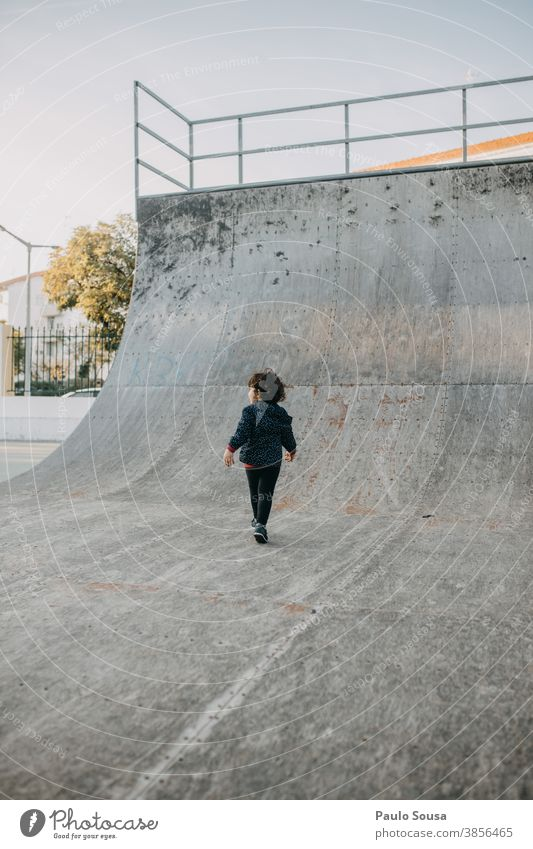 Rear view child playing at skate park Skateboarding Skate park Halfpipe Child childhood Children's game Park Autumn Authentic copyspace Copy Space Infancy