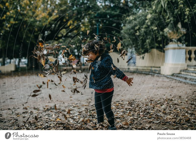 Little girl playing with autumn leaves Autumn Autumn leaves Autumnal Child childhood Children's game Playing Happy Happiness Day 1 - 3 years Exterior shot