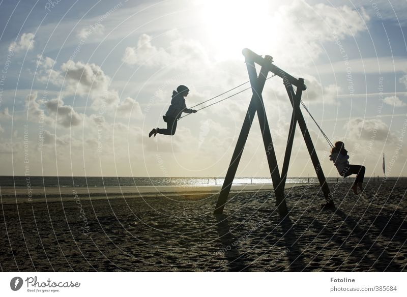We've got him! We've got him! Human being Child Girl Infancy Environment Nature Landscape Sun Coast Beach North Sea Happy Bright Natural Swing To swing Playing