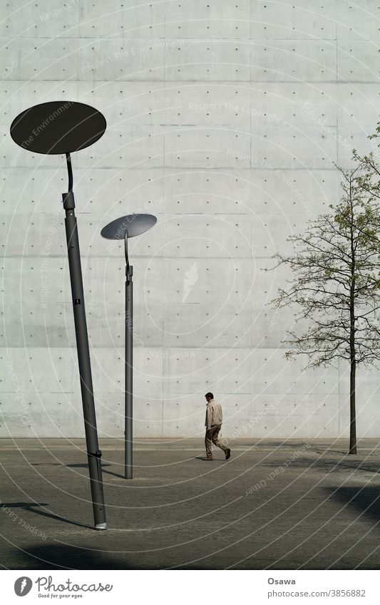Bowed in front of building Town Architecture Building Facade Wall (barrier) Wall (building) exposed concrete lanterns slanting Man Tree city tree Bleak texture