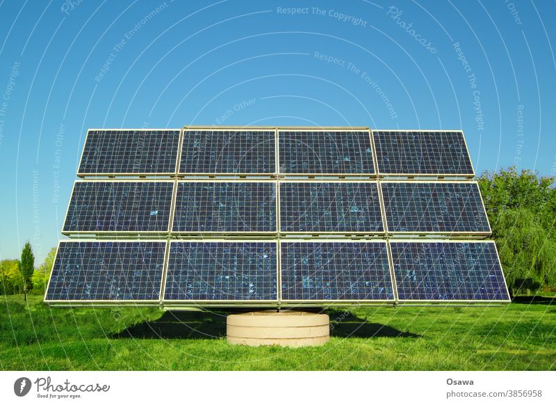 Solar collector on a green meadow against a clear blue sky Solar Power Solar cell Energy Energy industry Force power station power supply Renewable energy