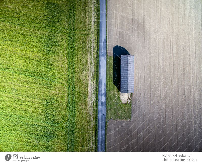 agricultural hut photographed from the air corn soil farmer light grassy line harvest farming green harvester farmland outdoors day road earth parallel