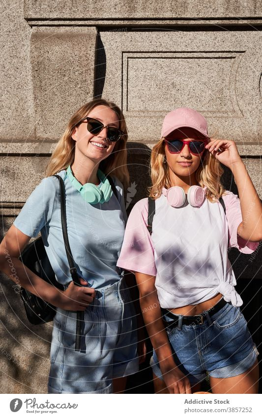 Trendy young women with standing in city friend urban blonde trendy together happy teenage cheerful girl sunglasses girlfriend headphones cool millennial