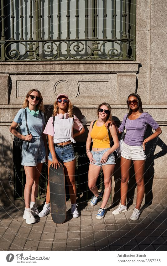 Trendy young women with skateboard in city friend group urban trendy together happy teenage cheerful girl sunglasses longboard girlfriend cool millennial skater