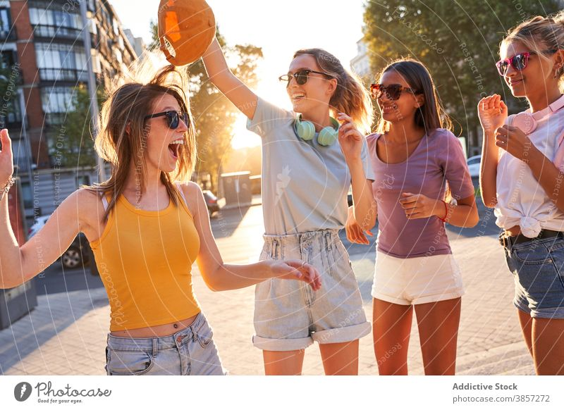 Group of cheerful teenagers dancing on street girlfriend having fun group city dance carefree summer happy together diverse multiethnic multiracial female