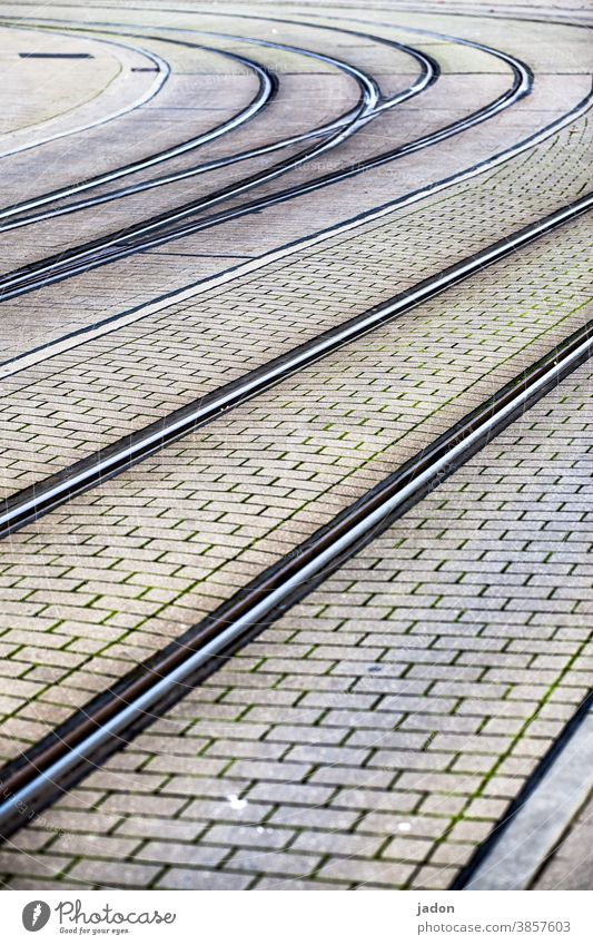 that bend. Railroad tracks Transport Tram Lanes & trails Traffic infrastructure Rail transport Road traffic Deserted Public transit Paving stone Curve Bend