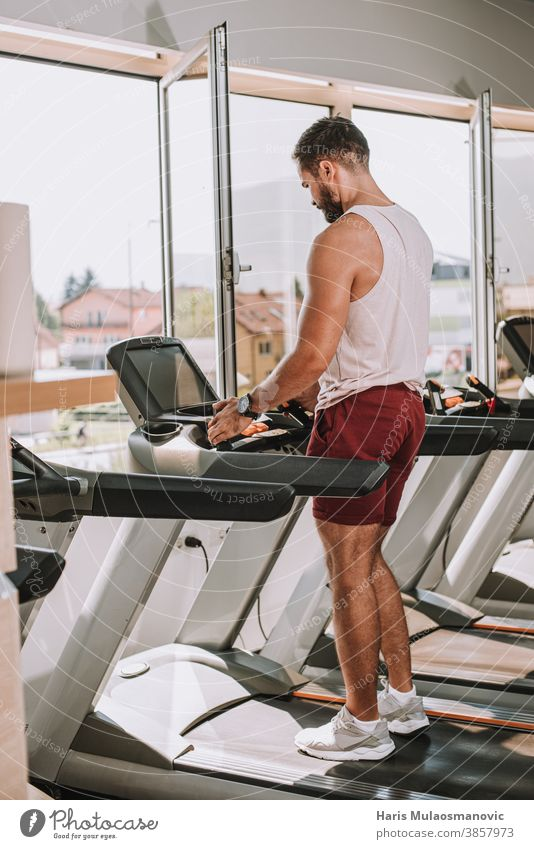 Man exercise  on treadmill in gym active activity adult athlete athletic body club dedication equipment female fit fitness gym time health healthy