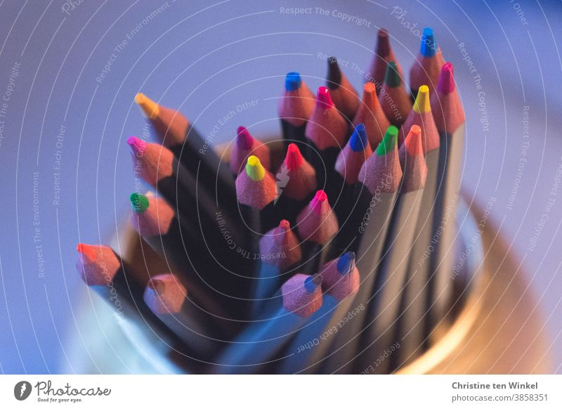 Crayons in bright colours stand with the tips pointing upwards in a gold-coloured cup crayons Colour Multicoloured Happiness Handicraft Leisure and hobbies