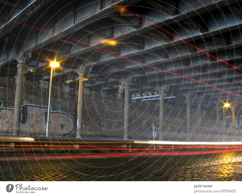 new light tracks in the old tunnel Tunnel Bridge Traffic infrastructure Cobblestones Street lighting Tracer path Speed Mobility Nostalgia Time Underpass Column