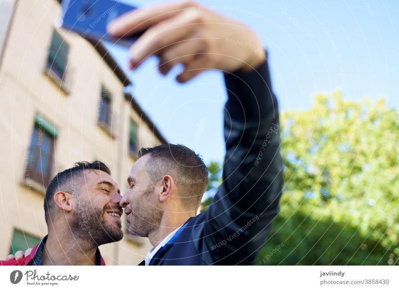 Gay couple making a selfie with their smartphone. gay men kiss kissing male love homosexual lgbt lgbtq relationship lovers albaicin granada boyfriend people