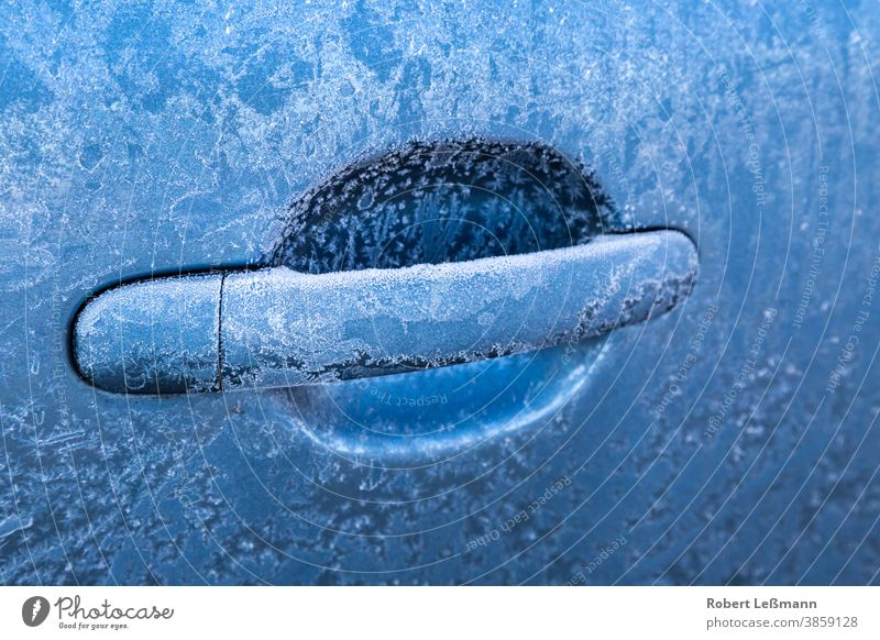 frozen car handle on a blue car Car frost door lock ice crystals unlock temperatures cars locked motor vehicle cool climate winter cold snow icy texture